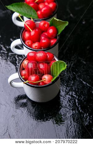 Cherry In Enamel Cup On Black Background. Healthy, Summer Fruit. Cherries.