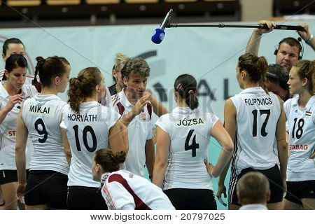 SZOMBATHELY, HUNGARY - JUNE 3: Hungarian players listening to their trainer at a CEV European League woman's volleyball game Hungary vs Bulgaria on June 3, 2011 in Szombathely, Hungary.