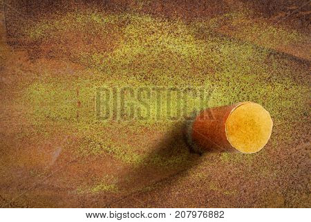 One cigarette butt on a yellow grunge background