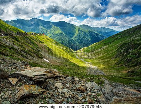 Mountain landscape. Carpathian Mountains in Romania. Cliffs nearby Transfagarasan road. High mountain peaks. reen mountain valley. Scenic landscape. Romania. Place for active recreation and hiking