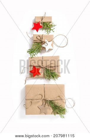 Gift boxes with star shaped paper tags on white background. Christmas. Advent