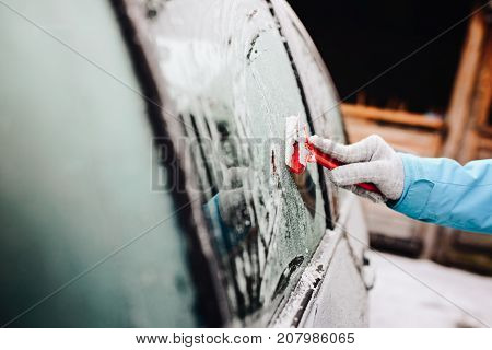 Woman Removing Ice From Side Car Windshield