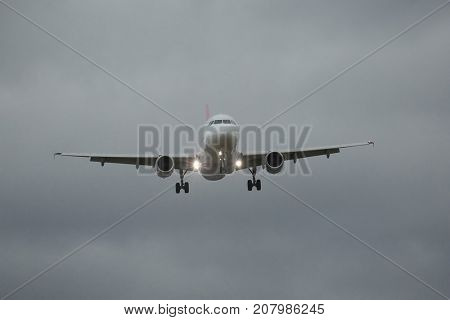 Plane approaching with landing lights
