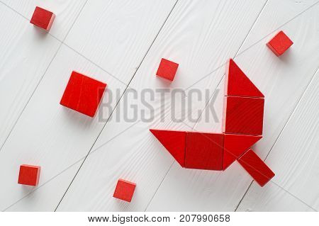 Red wooden blocks on white wooden background top view. Abstract merger and acquisition business concepts join company.