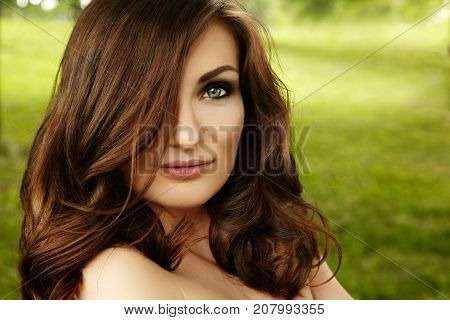 Beautiful Woman With Fashion Makeup, Volume Hair Style On Green Background Summer Nature. Sexy Hairs