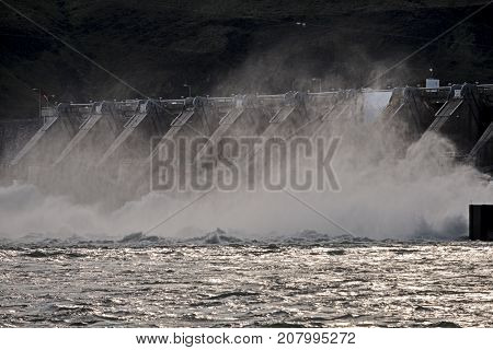 Water rushes over Wanapum Dam on the Columbia River to generate hydroelectric power for the Pacific Northwest.