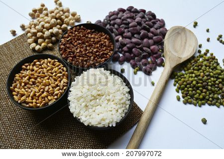 cereals, peas, buckwheat, rice, barley and beans on the table, different types of cereals for the preparation of various dishes