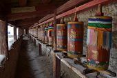 The Tibetan kora or pilgrimage and prayer wheels in Langmusi Amdo Tibet - China. Pic was taken in September 2017. poster