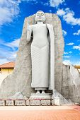 Buddha statue at the Uthpalawanna Sri Vishnu Devalaya Temple in Devinuwara near Matara Sri Lanka poster