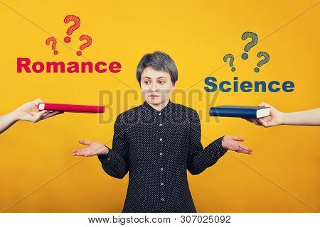 Puzzled Young Woman Student Balancing Hands Thinking What To Read Between A Science Book And Romance