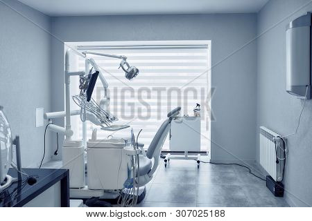 View From Side Of Professional Dental Equipment And Modern Tools In Dentist Office. Computer, Device