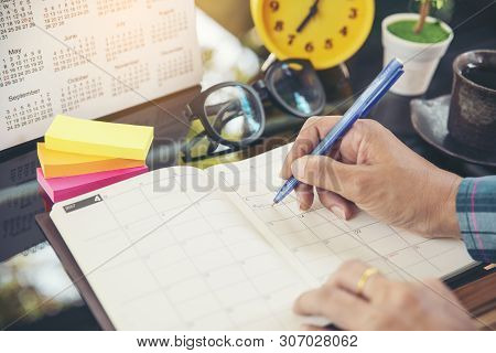 On 2019 Calendar Page,female Hand Planner Or Organizer Writing Daily Appointment.woman Mark And Note