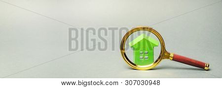Miniature Wooden House And Magnifying Glass. Home Appraisal. Property Valuation. House Searching Con
