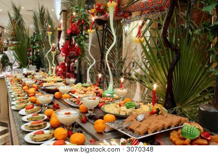 Table with fruit citrus and dessert in hotel restaurant poster