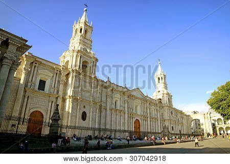 Many People Relaxing In Front Of Basilica Cathedral Of Arequipa, Spectacular Landmark In The Heart O