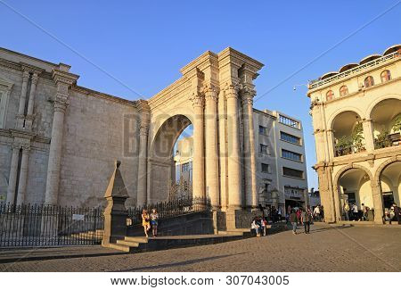 Plaza De Armas Square And The Ornamental Arch Of Arequipa Cathedral With Many Visitors, Arequipa Old
