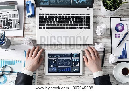 Businessman Working At Office Desk With Financial Data. Professional Invest Management And Consultin