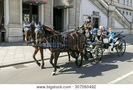 Viena, Austria - March 18, 2019: Horse Cart Rides On The Viennese Street