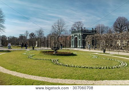 Viena, Austria - March 18, 2019: Picturesque Lawn With Flowers Planted On It Near The Schonbrunn Pal