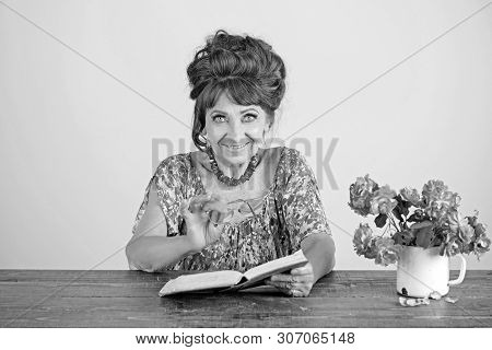 Old Woman Reading Book With Glasses At Flowers. Writer And Poet, Granny Read Fairytale. Teacher Or P