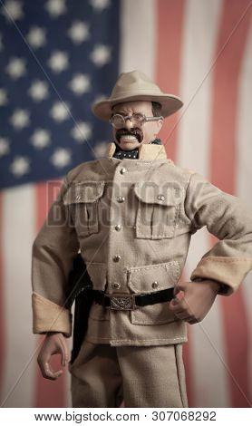JUNE 16 2019: Hasbro GI Joe action figure of Lieutenant Theodore Teddy Roosevelt with American Flag. Rough Rider uniform, battle of San Juan Hill Cuba