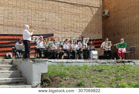 Zaraysk, Russia - May 9, 2019: Celebration Of Victory Day In City Park. On Stage Musicians Of The Br
