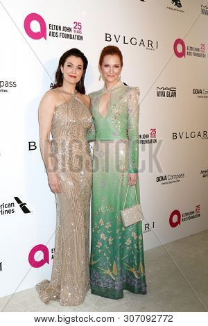 LOS ANGELES - MAR 4: Bellay Young, Darby Stanchfield at the 2018 Elton John AIDS Foundation Oscar Viewing Party at the West Hollywood Park on March 4, 2018 in West Hollywood, CA