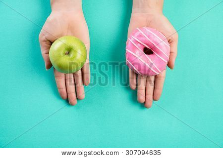 Healthy Lifestyle, Food And Sport Concept. Top View Of Healthy Versus Unhealthy. Woman Hand Holding