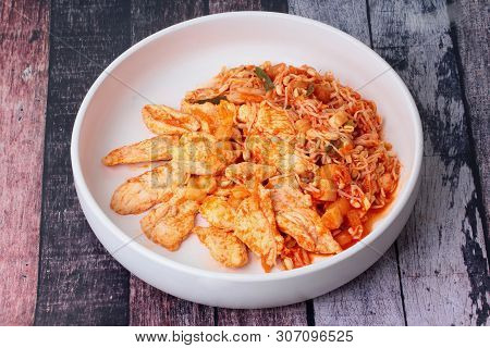 Fried Kimji With Skinless Chicken In Korean White Plate Served On Wood