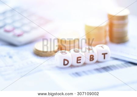 Debt Concept With Calculator Stack Coin On Invoice Bill Paper / Increased Liabilities From Exemption