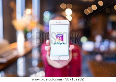 Hiang Mai, Thailand - Apr.08,2019: Man Holding Iphone With Instagram Application On The Screen. Inst