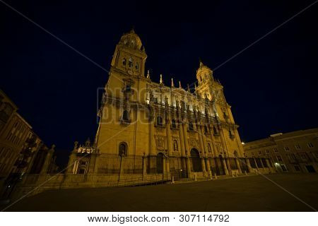 Jaen cathedral illuminated at night. Summery image with the empty streets of the city of Jaen in Spain poster