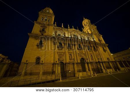 Tourism, Jaen cathedral illuminated at night. Summery image with the empty streets of the city of Jaen in Spain