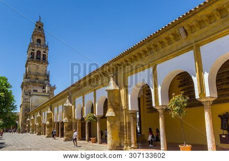 Cordoba, Spain - May 13, 2019: Bell Tower At The Courtyard Of The Mosque Cathedral In Cordoba, Spain
