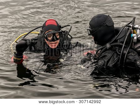Scuba Diving In A Mountain Lake, Practicing Techniques For Emergency Rescuers. Immersion In Cold Wat