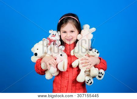 Cherishing memories of childhood. Small girl smiling face with toys. Happy childhood. Little girl play with soft toy teddy bear. Lot of toys in her hands. Childhood concept. Collecting toys hobby poster
