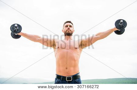 Muscular Man Exercising With Dumbbell. Dumbbell Exercise. Strong Biceps And Triceps. Gym Workout. Wo