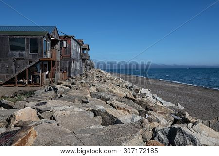 Nome, Alaska - June 8: Historic Nome And The Bering Sea Where It Borders Front St On June 8 2019 In