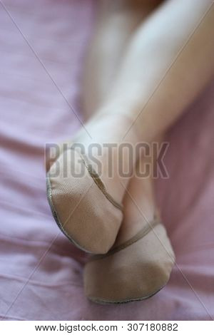 legs with rhythmic gymnastics toe shoes on white background poster