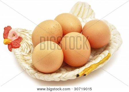 Easter Eggs on hen decorative nest on white background poster