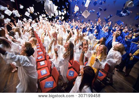 Wilmington De: Charter School Of Wilmington Students  Celebrate By Tossing Their Caps During The Fin