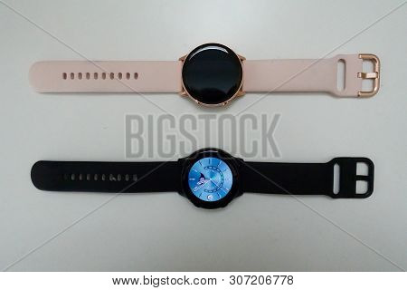 Orlando, Fl/usa- 6/18/19: A Black And Rose Gold Samsung Galaxy Active Watches Open With A Standard A