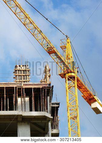 Crane. Self-erection Crane Over Construction Site. Crane Near Bulding.