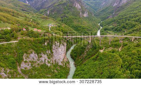 Tara River Canyon. Most Popular Place For Visit Is The Durdevica Bridge. Jurjevich Bridge In Zabljak