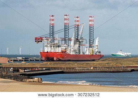 GORLESTON, NORFOLK,  ENGLAND - March 2019: Seajacks Scylla wind turbine installation vessel moored in Great Yarmouth Outer Harbour, i n Norfolk, England