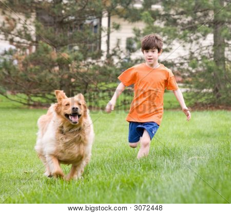 Little Boy Having Fun Racing the Dog poster