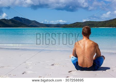 Young Man Enyoing View Over Whiteheaven Beach On A Beautiful Sunny Day With Clouds, Whitsunday Islan