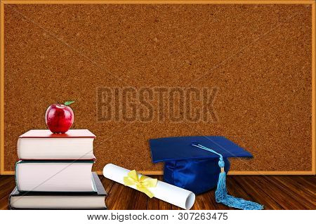 Education Concept With Blue Graduation Hat And Diploma And Stack Of Books With Apple On Cork Board B