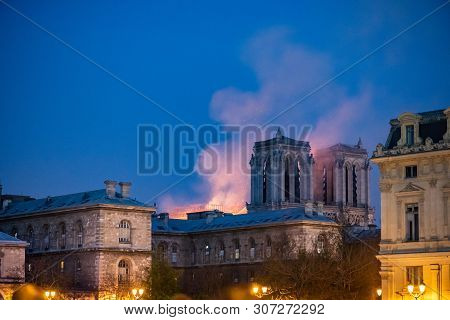 Paris, France - April 15th, 2019 : Notre-dame Still Burning At Night, A Few Hours After The Beginnin