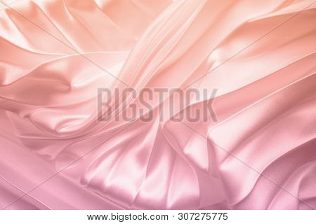 Silk Or Satin Fabric Folded Background. Coral Gradient Color. Luxurious Fabric Cloth Fold Glamour Ba